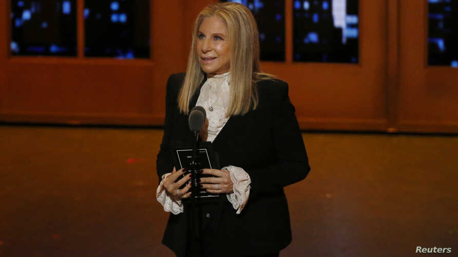 FILE - Singer Barbra Streisand speaks on stage during the American Theatre Wing's 70th annual Tony Awards in New York, U.S., June 12, 2016.