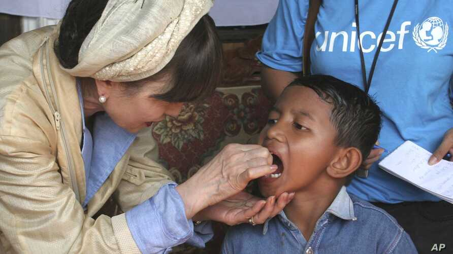 FILE - Renowned Japanese actress Tetsuko Kuroyanagi who is a UNICEF Goodwill Ambassador gives an Indonesian boy a measles vaccination Thursday Feb. 3, 2005 in the remote village of Keudai Tenom on Aceh's West coast.