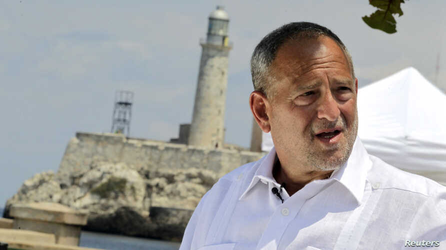 Scott Gilbert, lawyer for jailed U.S. contractor Alan Gross, talks to the media in front of the colonial-era Morro Cabanas fortress in Havana, Cuba, April 23, 2014.