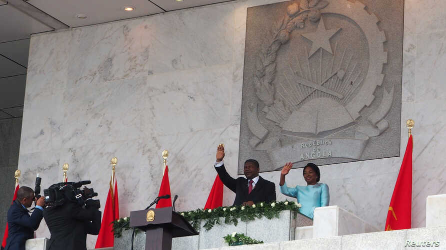 Angola's new president Joao Lourenco waves after being sworn in as the country's first new leader in 38 years in Luanda, Angola, Sept. 26, 2017.