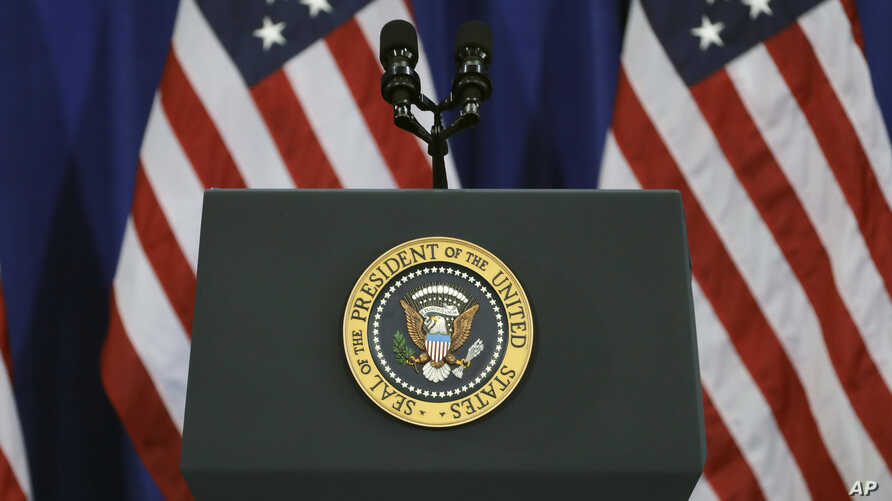 FILE - The U.S. presidential seal is seen on a podium at MacDill Air Force Base, in Tampa, Florida, Dec. 6, 2016.