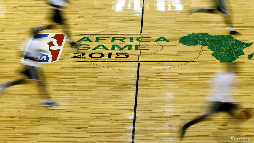 FILE - NBA players take part in a training session in Johannesburg, July 31, 2015.