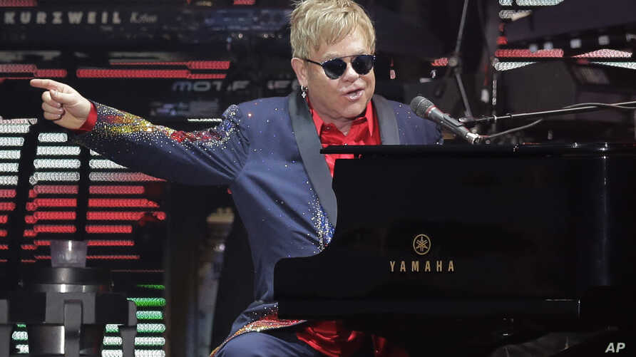 FILE - Elton John performs following the Formula One U.S. Grand Prix auto race at the Circuit of the Americas in Austin, Texas, Oct. 25, 2015..