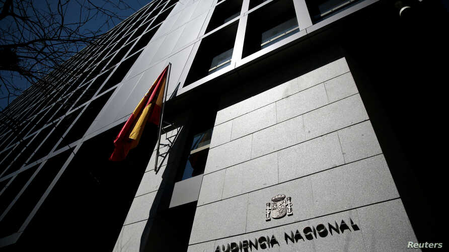 FILE - A Spanish flag waves at the entrance of Spain's High Court in central Madrid, Spain, April 18, 2016. Spanish authorities this week issued arrest warrants for several Russians - some reputedly associates of President Putin - suspected of having