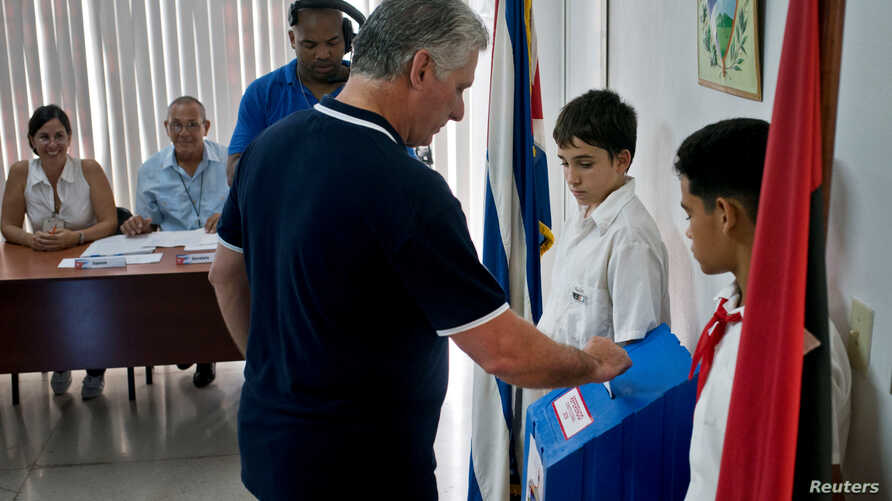 FILE - Cuba's President Miguel Diaz-Canel casts his vote during the referendum to approve the constitutional reform in Havana, Cuba, Feb. 24, 2019.