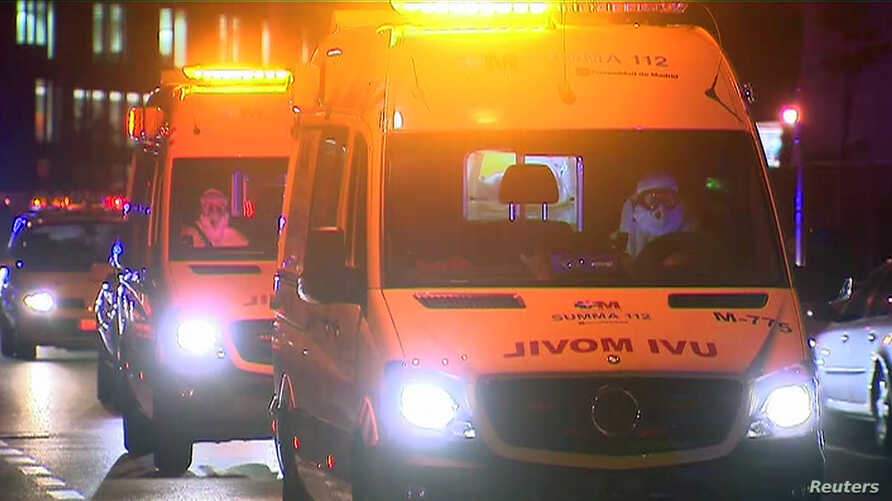 An ambulance carrying a Spanish nurse who has contracted Ebola arrives at the Carlos III Hospital in Madrid, Oct. 7, 2014, in this still image taken from video.