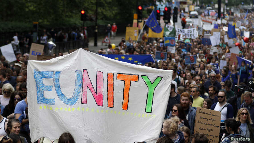 """People hold banners during a """"March for Europe"""" demonstration against Britain's decision to leave the European Union, in central London, Britain, July 2, 2016. Britain voted to leave the European Union in the EU Brexit referendum."""