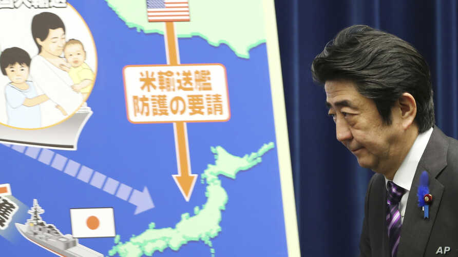 Japanese Prime Minister Shinzo Abe arrives for a press conference at his official residence in Tokyo, July 1, 2014.