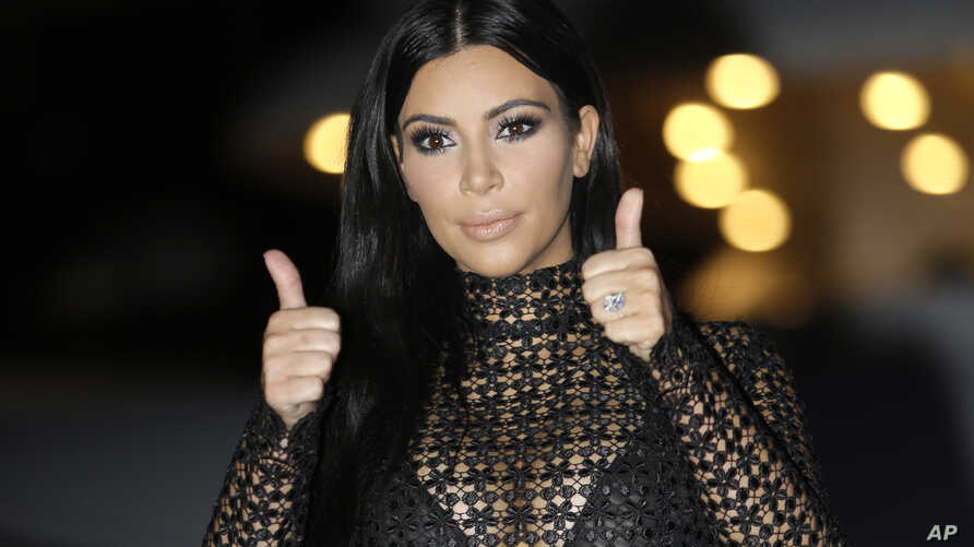 FILE - American television and social media personality, socialite, and model Kim Kardashian poses during a photocall at the Cannes Lions 2015, International Advertising Festival in Cannes, southern France.