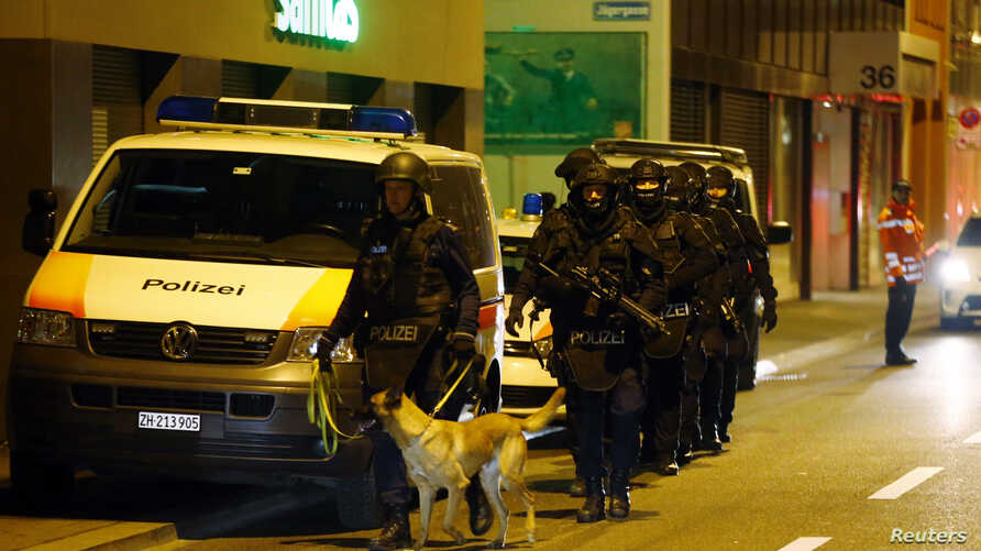 Police stand outside an Islamic center in central Zurich, Switzerland December 19, 2016.