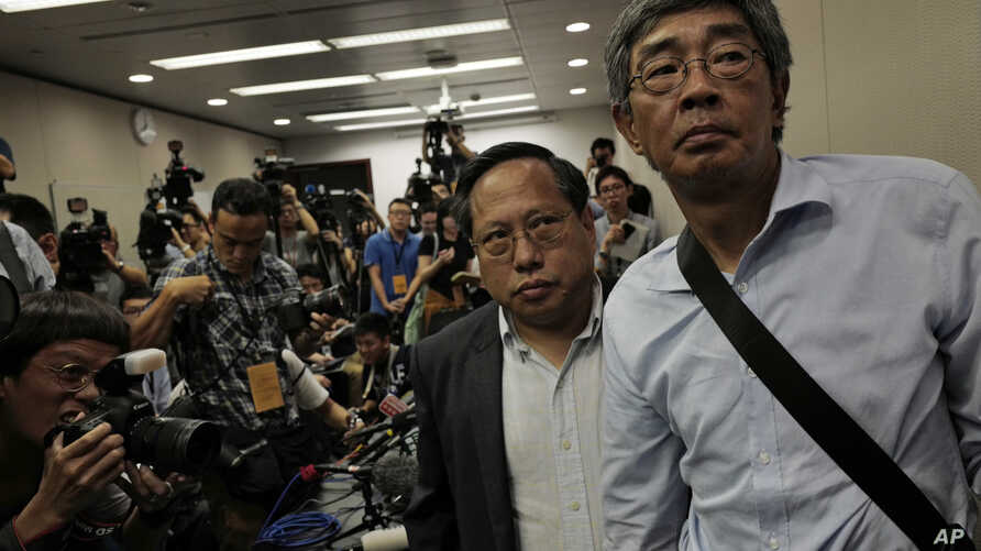 Freed Hong Kong bookseller Lam Wing-kee, right, is accompanied by pro-democracy lawyer Albert Ho after giving a news conference in Hong Kong, June 16, 2016.