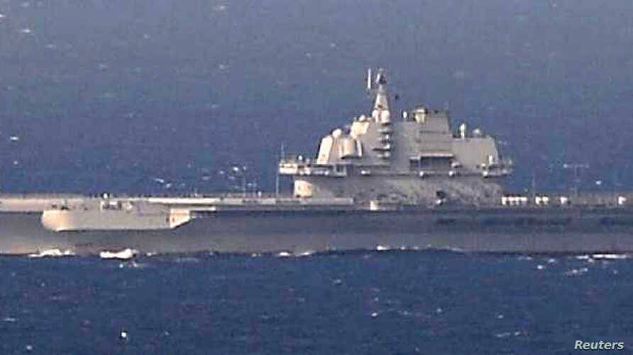 China's  aircraft carrier Liaoning sails the water in East China Sea, in this photo taken Dec. 25, 2016 by Japan Self-Defence Force.