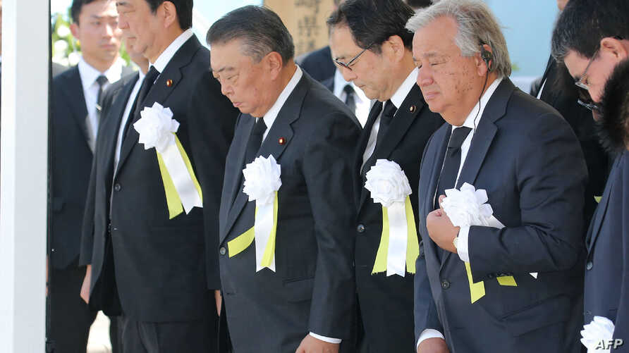 U.N. Secretary-General Antonio Guterres (R) and Japan's Prime Minister Shinzo Abe (L) attend a memorial ceremony to mark the 73rd anniversary of the atomic bombing of Nagasaki, at the Peace Memorial Park in Nagasaki, Japan, Aug. 9, 2018.
