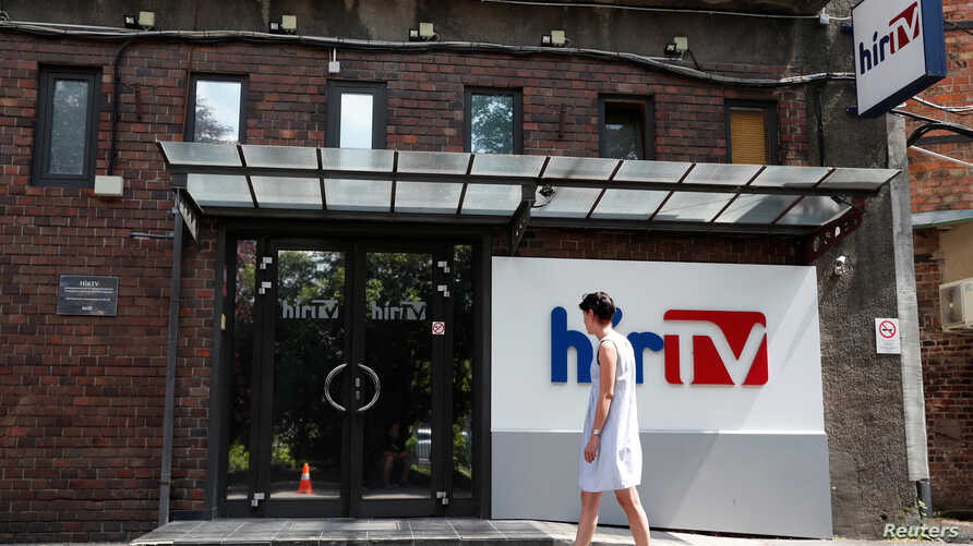 The entrance to Hir TV headquarters is pictured in in Budapest, Hungary, Aug. 1, 2018. Hir TV is among the media operations being donated to a foundation, creating a huge right-wing media conglomerate.