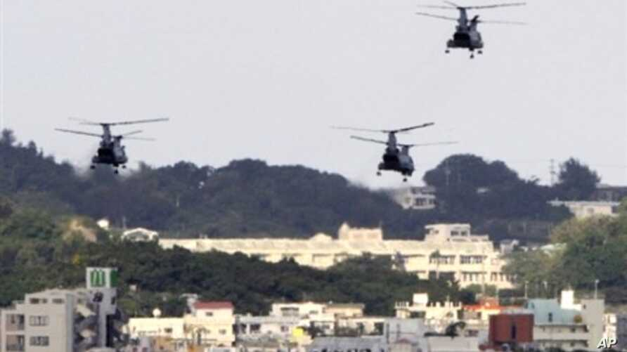 US military helicopters flying over the US Marine Corps Futenma Air Base in Ginowan, Okinawa Prefecture, Japan (2009 file photo)