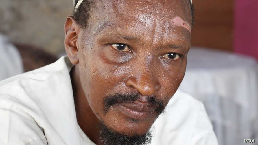 Jeronimo Lokolonyei Lorinyok, 51 - also known as Maalim Yusuf - a preacher, and a trainee with terror group in Somalia, said he was recruited by a terror suspect in police custody, Mombasa, Kenya, October 2013. (M. Yusuf/VOA)