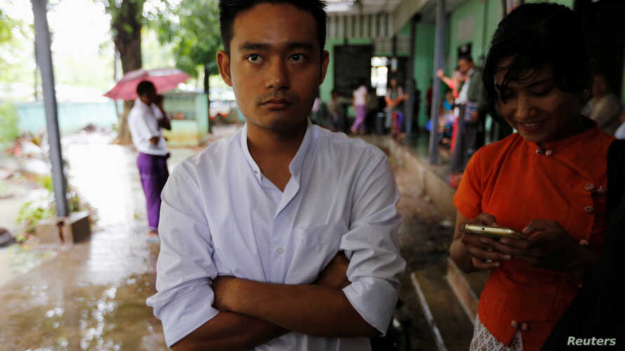 Poet Maung Saung Kha, 23, stands after a court sentenced him to six months in jail for defaming former president Thein Sein, making him one of the first political activists sentenced since Nobel Peace Prize laureate Aung San Suu Kyi took power in Yan