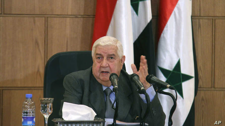 In this photo released by the Syrian official news agency SANA, Syrian Foreign Minister Walid Moallem, speaks during a press conference, in Damascus, Syria, April 6, 2017.