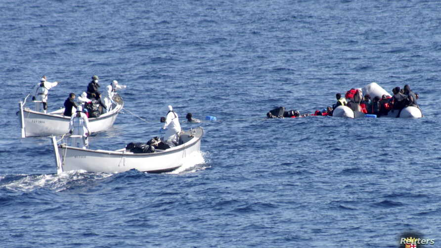 FILE - Migrants are rescued by the Italian Navy in the Mediterranean Sea, in this picture released on January 28, 2016 by Italian Navy.