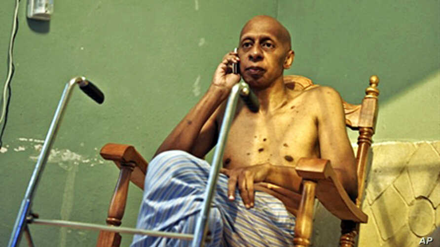 Cuban dissident Guillermo Farinas receives confirmation by mobile phone that he has been awarded the Sakharov Human Rights Prize by the European Parliament, 21 Oct. 2010