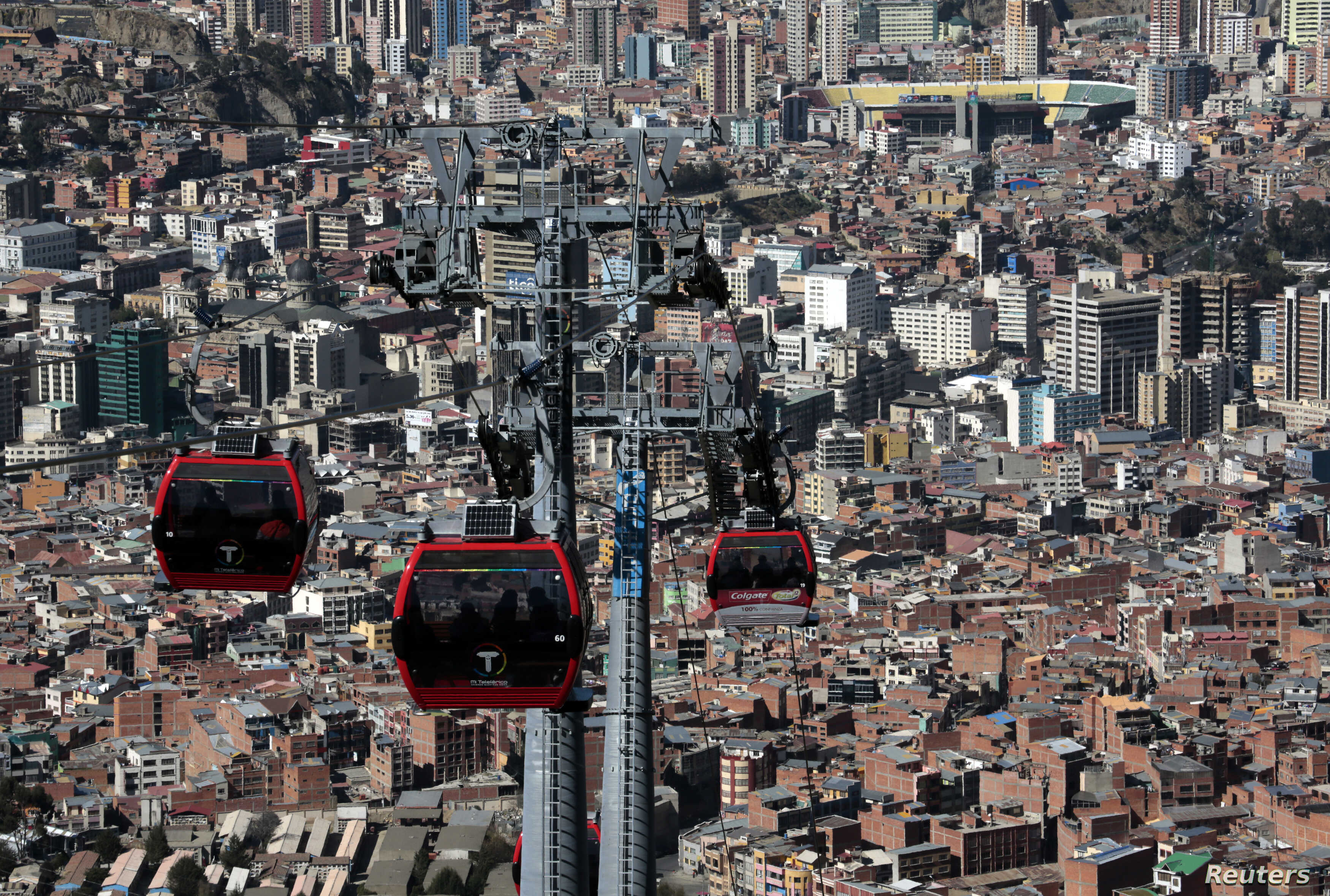 Cable cars travel over La Paz, Bolivia, July 23, 2015. Bolivia already has the largest urban cable car system in the world.