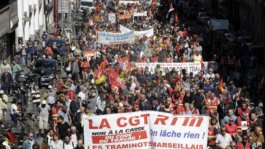 Workers demonstrate in Marseille, southern France, Sept. 12, 2017.