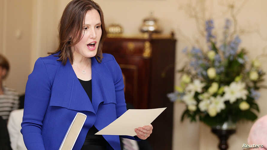 FILE - Minister for Small Business Kelly O'Dwyer is sworn in by Governor-General Peter Cosgrove at Government House in Canberra, Sept. 21, 2015.