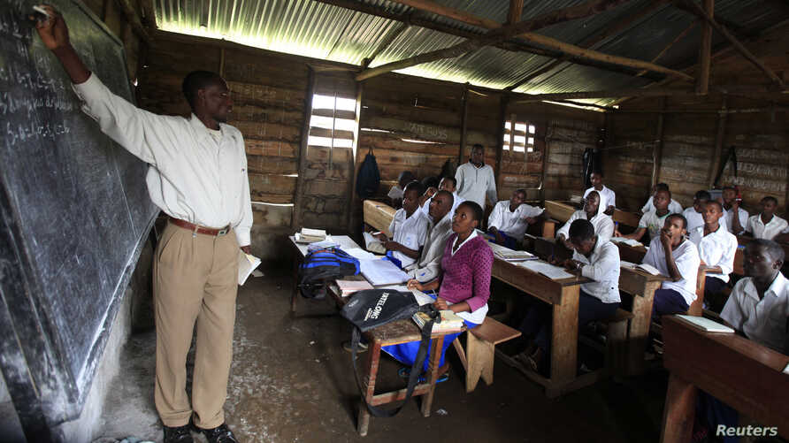 A teacher conducts a mathematics lesson to high school students in Democratic Republic of Congo town of Bunagana, Oct. 19, 2012.