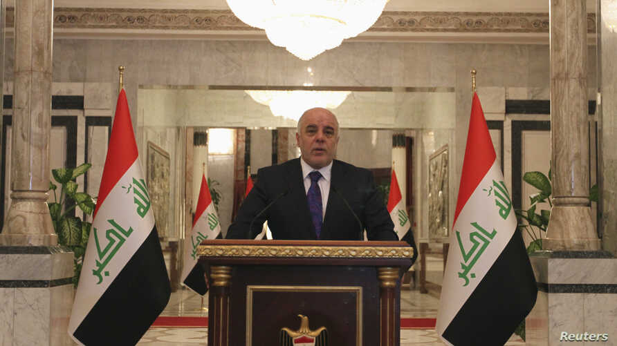 FILE - Iraq's Prime Minister-designate Haider al-Abadi speaks during a news conference in Baghdad.