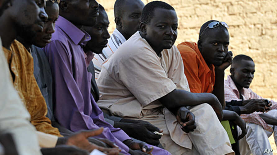 Nigerian men who recently left war-torn Libya rest after arriving to their village, Dofalis, 190km away from Niamey, on September 8, 2011.