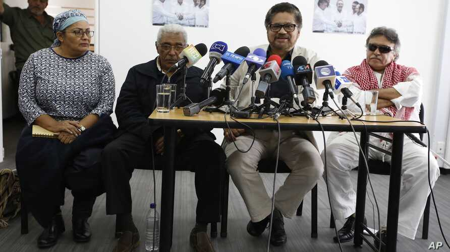 Chief negotiator of the Revolutionary Armed Forces of Colombia, or FARC, Ivan Marquez, second right, talks to reporters during a press conference in Bogota, Colombia, Dec. 6, 2016.