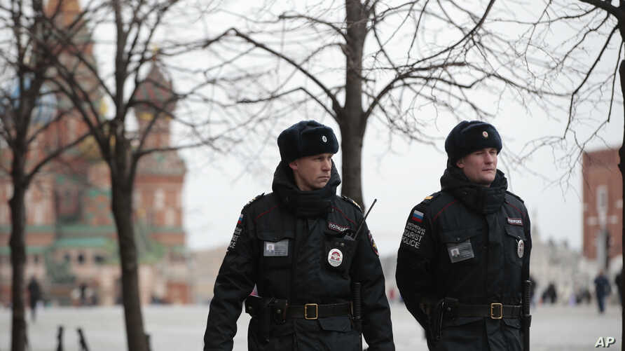 FILE - Police officers patrol Red Square in Moscow, Russia, March 22, 2016.
