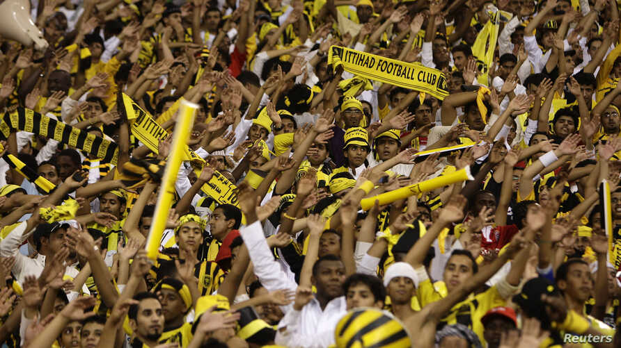 FILE - Fans cheer during a soccer match at King Fahad stadium in Riyadh, Saudi Arbia, May 7, 2010. Saudi authorities announced Sunday an alleged terror cell had planned to place a car bomb outside Al-Jawhara stadium in Jeddah during an October 11 mat