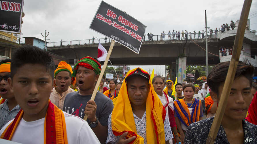 FILE - Activists of All Assam Students' Union (AASU), along with 28 other organizations walk during a protest rally against India's Citizenship Amendment Bill 2016 in Gauhati, northeastern Assam state, India, June 29, 2018.