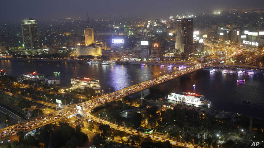FILE - Rush hour traffic fills the 6 October bridge over the Nile River in Cairo, Egypt. Uber is launching a new minibus service on Tuesday, Dec. 4, 2018, in traffic-mad Cairo, Egypt's capital and the ride-sharing U.S. giant's fastest-growing market.