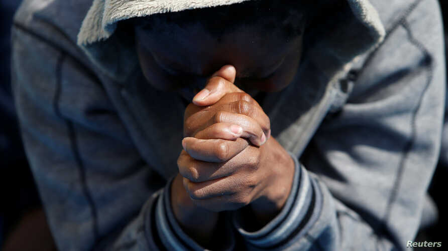 A migrant prays on the Migrant Offshore Aid Station ship Topaz Responder after being rescued around 20 nautical miles off the coast of Libya, June 23, 2016.