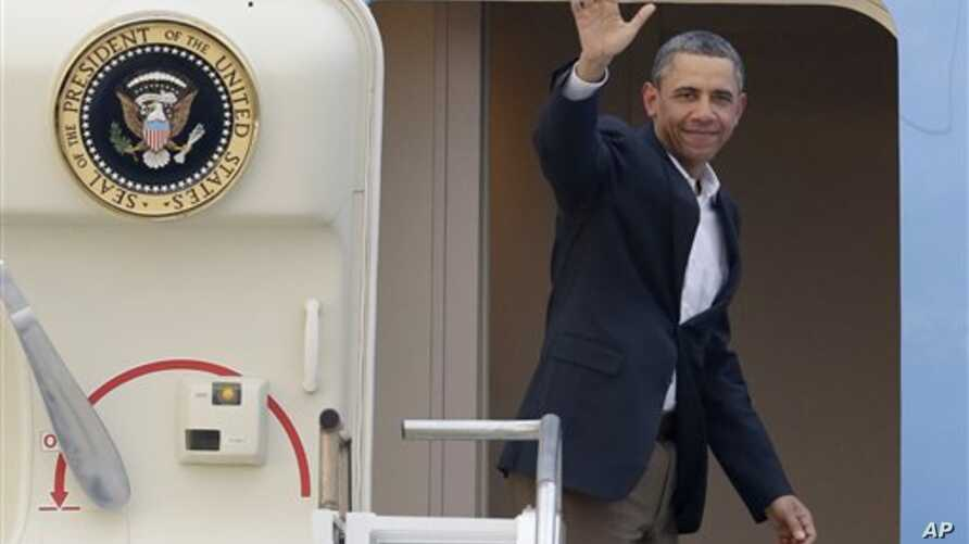 President Barack Obama waves from Air Force One, February 18, 2013, as he departs West Palm Beach, where he spent the Presidents Day weekend playing golf.