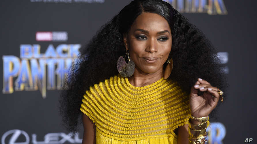 """Angela Bassett, a cast member in """"Black Panther,"""" poses at the premiere of the film at the El Capitan Theatre, Jan. 29, 2018, in Los Angeles."""