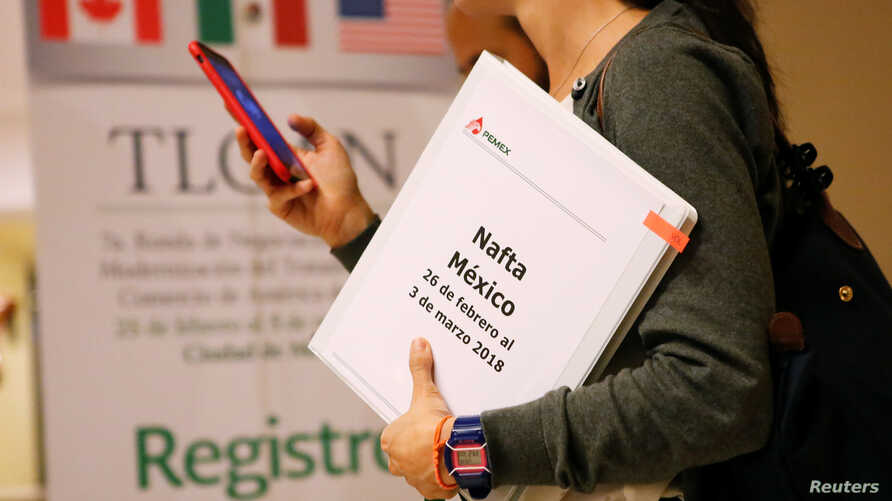 A member of the Mexican negotiation team checks her phone during a lunch break at the hotel where the seventh round of NAFTA talks involving the United States, Mexico and Canada takes place, in Mexico City, Mexico, Feb. 28, 2018.