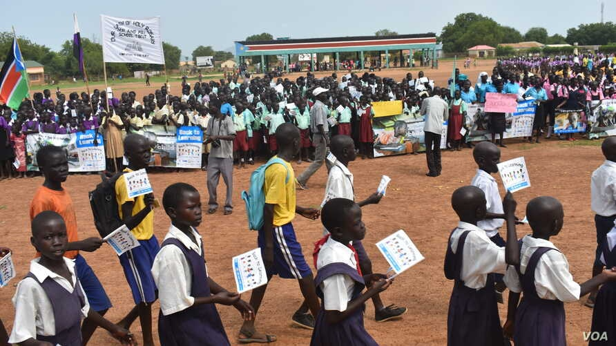 Students and education officials participate in a get-back-to-school campaign launched in Imatong state, South Sudan, June 7, 2017. (D. Silva/VOA)