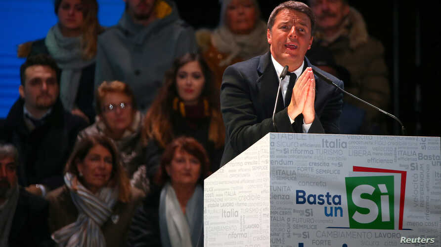 """Italian Prime Minister Matteo Renzi speaks during the last rally for a """"Yes"""" vote in the upcoming referendum about constitutional reform, in Florence, Italy, Dec. 2, 2016."""