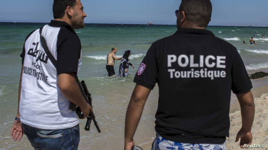 Tourist police officers patrol at the beach  in Sousse, Tunisia, July 1, 2015.