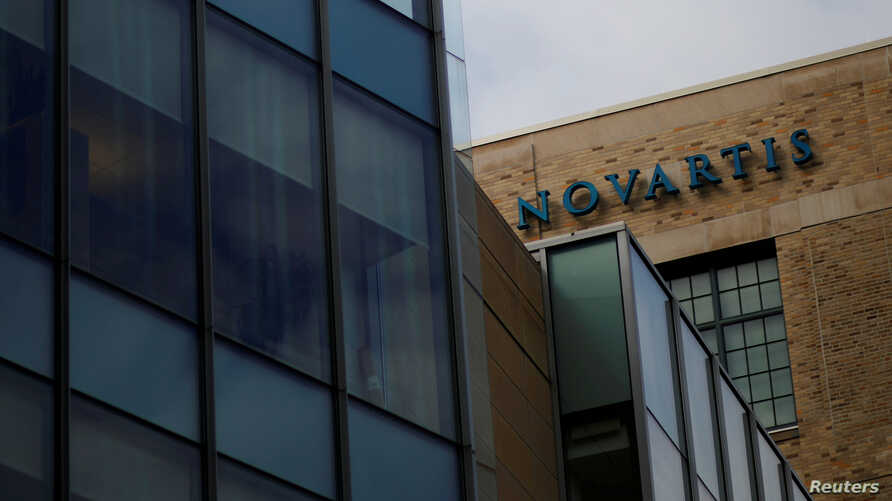 FILE - A sign marks a building on Novartis' campus in Cambridge, Massachusetts, Feb. 28, 2017.
