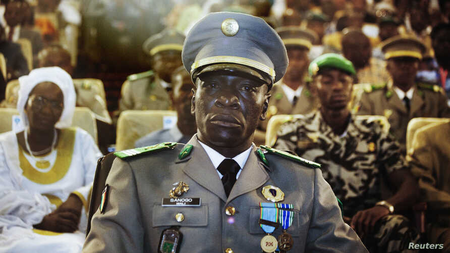 FILE - Coup leader General Amadou Sanogo attends a ceremony as former parliament speaker Dioncounda Traore (unseen) is sworn in as Mali's interim president in the captial Bamako.
