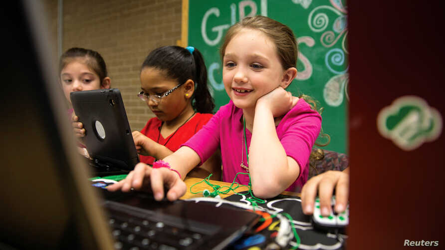 A Girl Scout works on a laptop computer, in a photo released June 21, 2017.