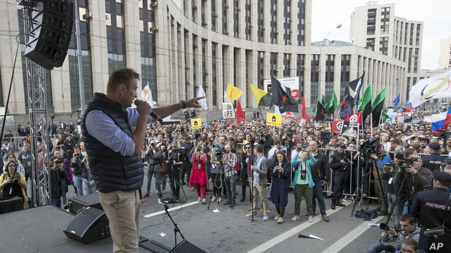 FILE - Russian opposition leader Alexei Navalny speaks during a rally against authorities' move to block parts of the internet in Russia, April 30, 2018.
