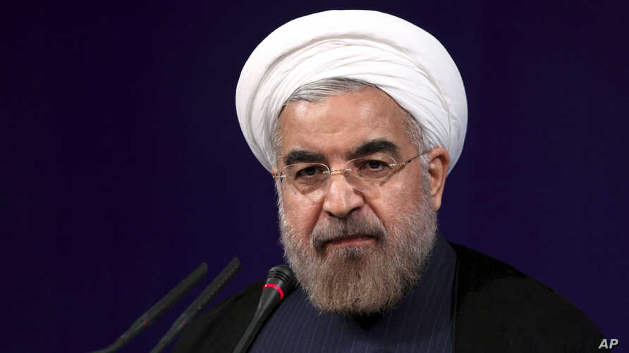 Iranian President Hasan Rouhani speaks at his first press conference since taking office at the presidency compound in Tehran, Iran,  Aug. 6, 2013.