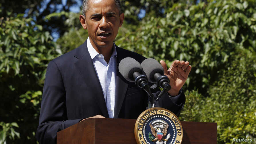 U.S. President Barack Obama makes a statement about the violence in Egypt while at his rental vacation home on the Massachusetts island of Martha's Vineyard in Chilmark, August 15, 2013.