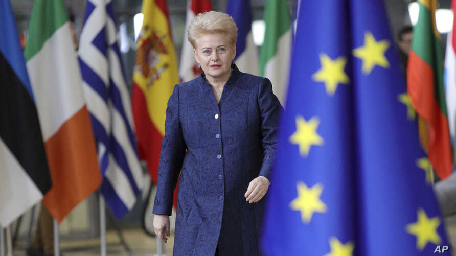 FILE - Lithuanian President Dalia Grybauskaite arrives for an EU summit at the Europa building in Brussels, Dec. 14, 2017.