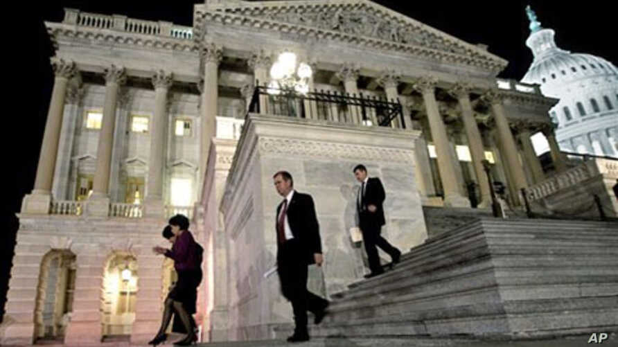 Congressmen walk down the steps of the House of Representatives as they work throughout the night on a spending bill, on Capitol Hill in Washington, February 18, 2011
